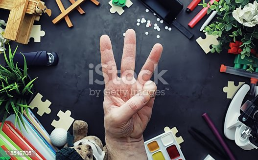 istock Background. Children's toys on the table. Space between kid's toys. 1185467051