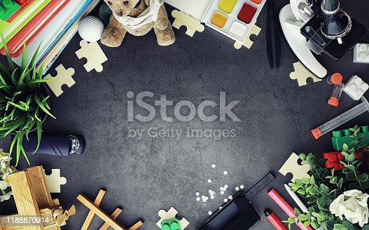istock Background. Children's toys on the table. Space between kid's toys. 1185870914