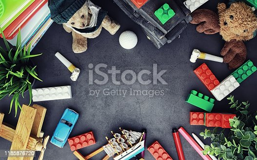 istock Background. Children's toys on the table. Space between kid's toys. 1185876720