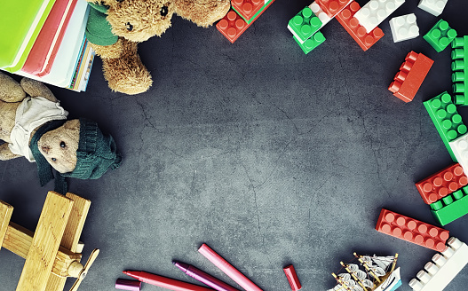 istock Background. Children's toys on the table. Space between kid's toys. 1186930930