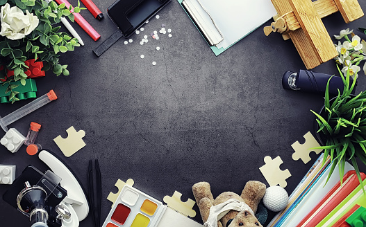 istock Background. Children's toys on the table. Space between kid's toys. 1186931016