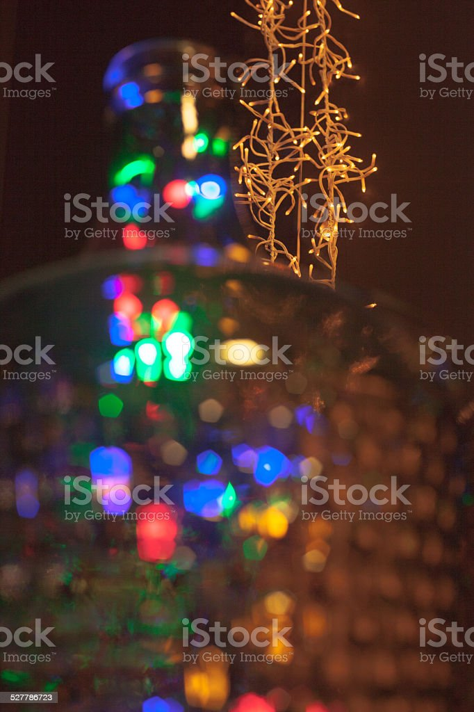 background christmas lights with colorful defocused foreground stock photo