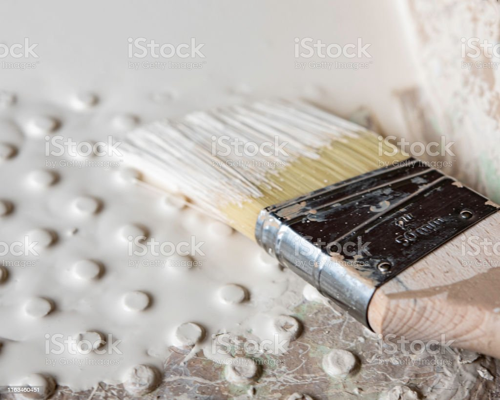 Close up background image with shallow focus of a two-inch trim paint...