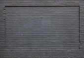 background consisting of part of anthracite brick wall