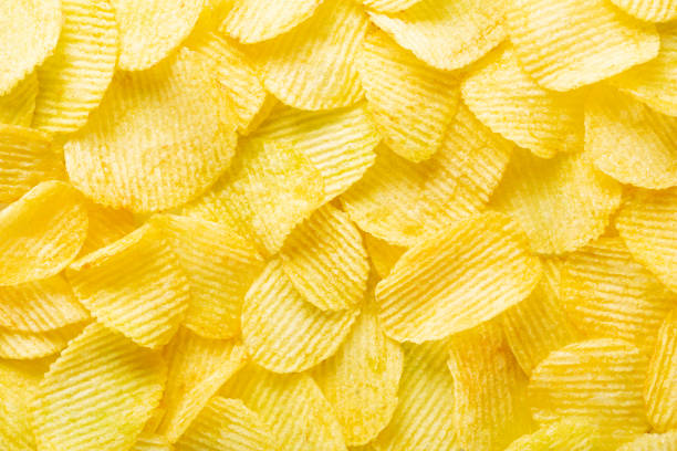 background corrugated golden chips with texture stock photo