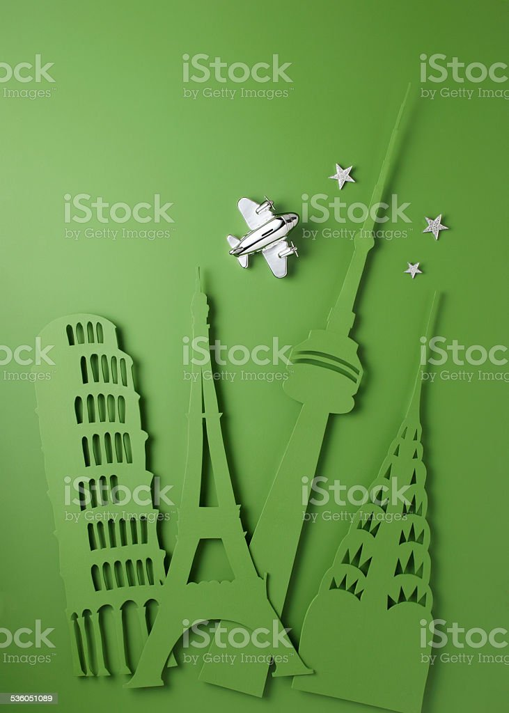 Background Cut outs of city landmarks with sterling silver plane stock photo