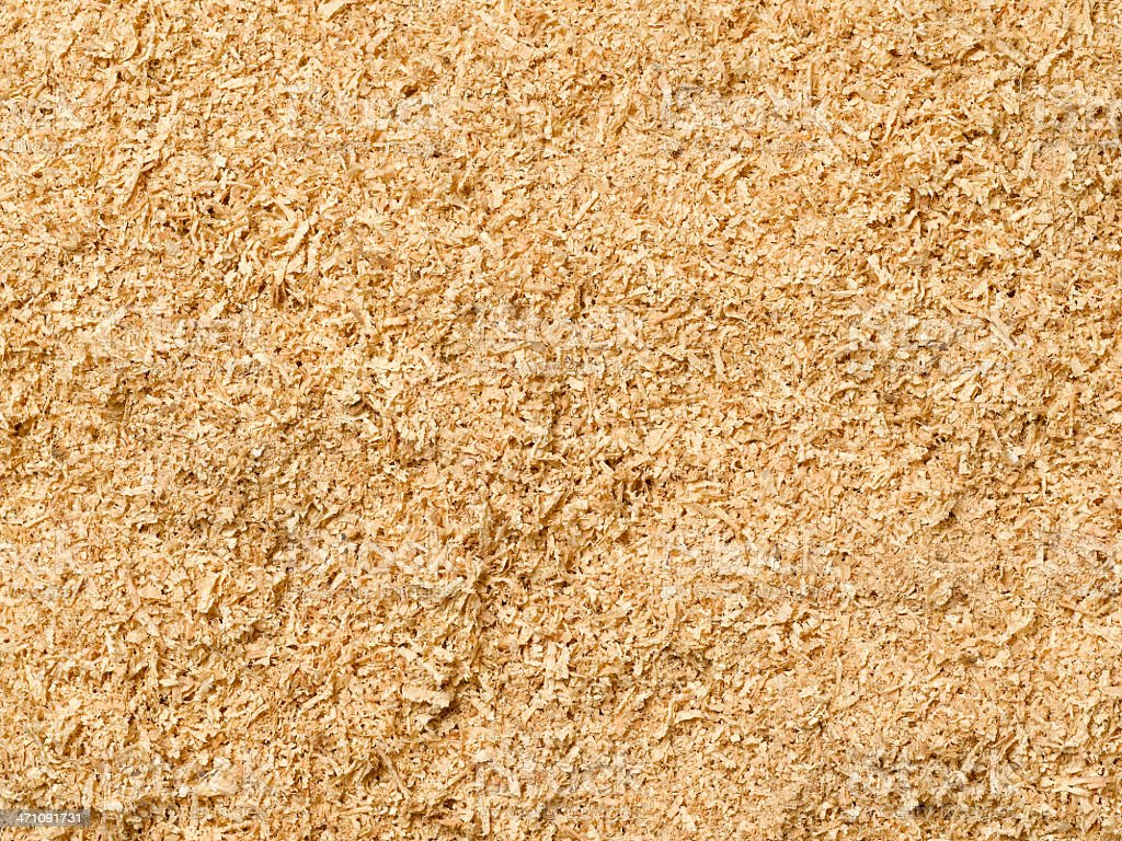 A background filled with sawdust stock photo