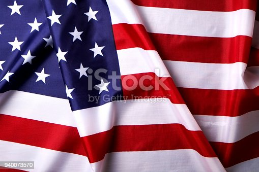 istock Background flag of the United States of America for national federal holidays celebration and mourning remembrance day. USA symbolics. 940073570