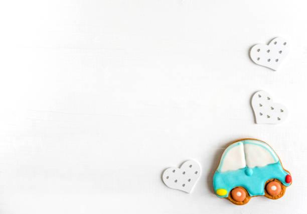 hintergrund für ein banner mit dem auto. kinder-banner. rahmen für grußkarte neugeborenen jungen. leer für kindisch banner design mit lebkuchen. - sterntaufe stock-fotos und bilder