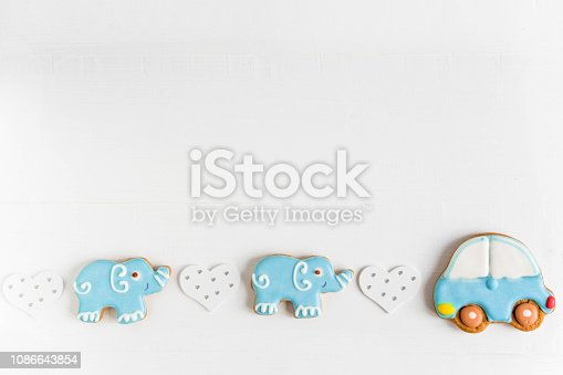 istock Background for a banner with elephants and car. Children banner. Frame for greeting card newborn boy. Blank for design childish banner with gingerbread. 1086643854
