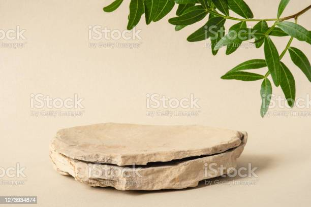 Photo of Background for cosmetic products of natural beige color.