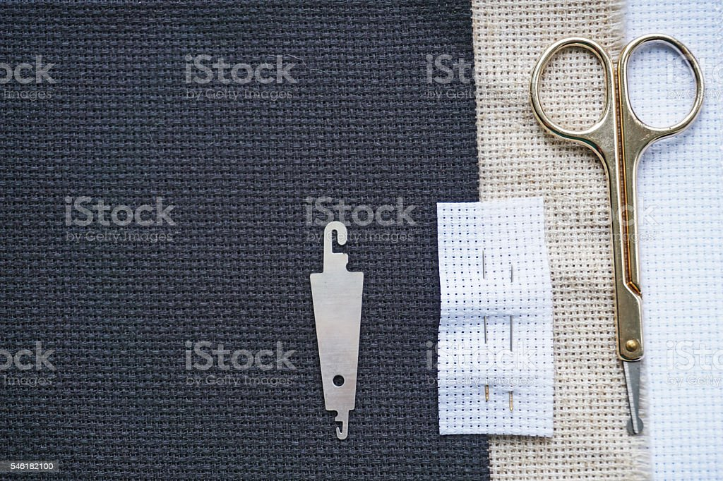 Background for cross stitch with multicolored yarn stock photo
