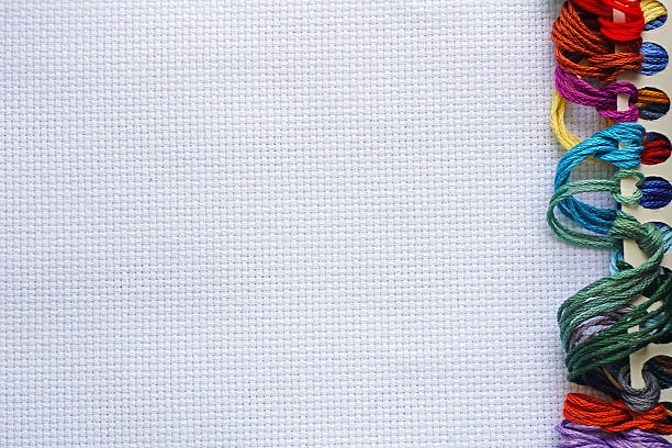 Background for cross stitch with multicolored yarn - foto de stock