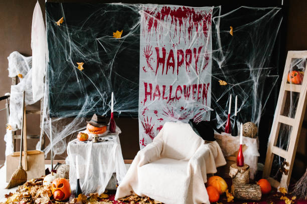 Background for Halloween celebration for party in night. Scary pumpkins, spider webs, blood, candles. Text Halloween happy.