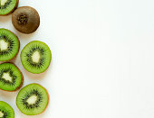 Background for the profile, design, printing with fruit. Fresh kiwi sliced. The basis for the banner with kiwi. Fresh and natkralnye vitamins.