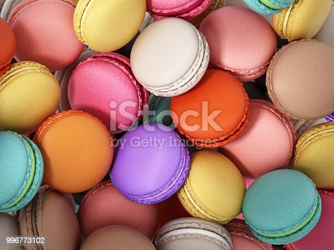 Background formed with stacked colorful macarons.