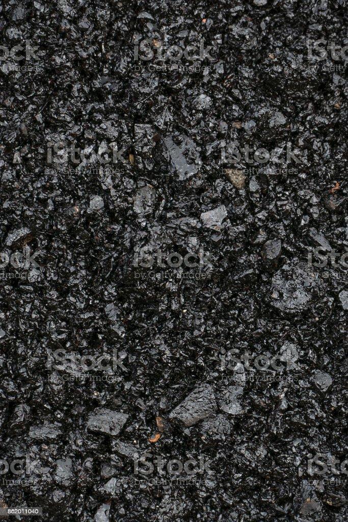 Background from black hot asphalt stock photo