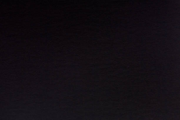 Background from black paper texture. Hi res stock photo