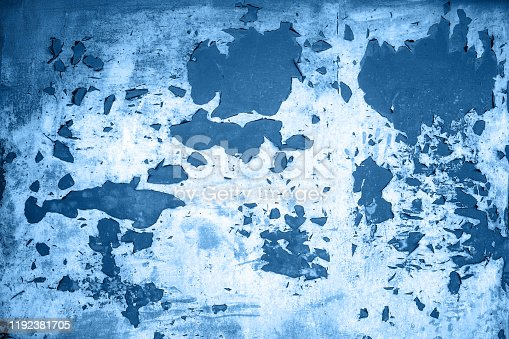 istock Background from blue color metal  door with paint peeling off from old age many year 1192381705