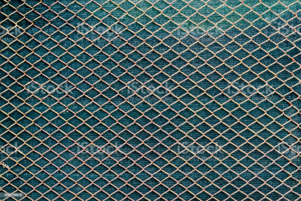 Background from chain link fence against a green background, Plana mountain stock photo