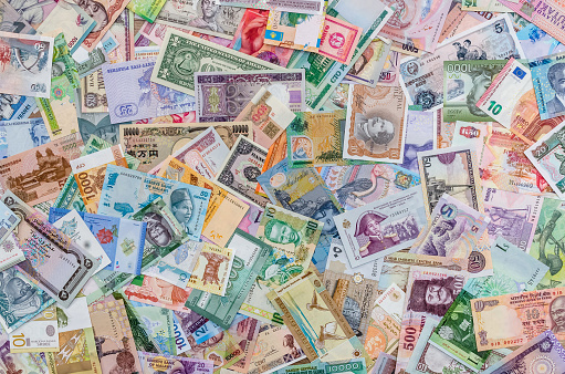 istock Background from collection of all world money banknotes 946032350