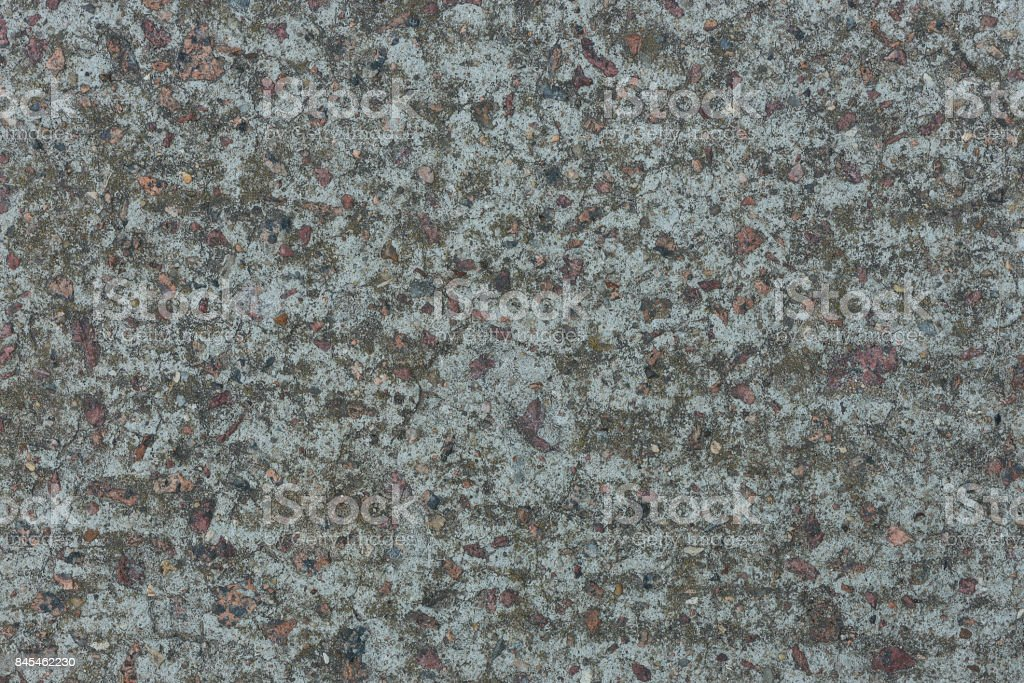 Background from concrete with impregnations from red granite gravel стоковое фото