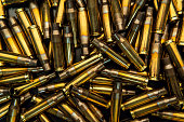 istock Background from empty cartridges for rifles and carbines. Shiny brass shells scattered on the surface. 1199927676