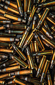 istock Background from empty cartridges for rifles and carbines. Shiny brass shells scattered on the surface. 1201247309