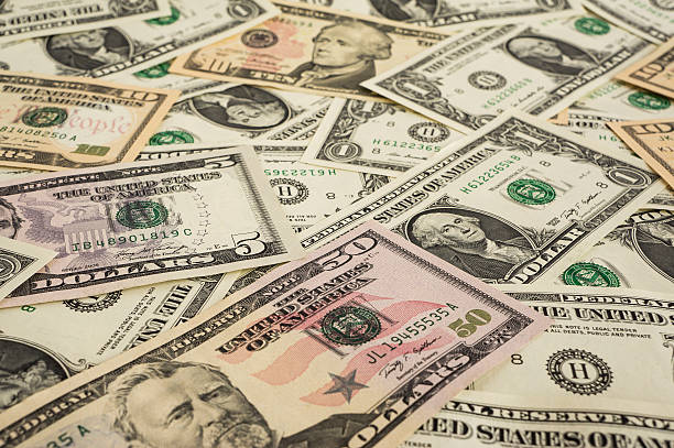 Background from money – 1, 5, 10, 50 dollars Background from money – 1, 5, 10, 50 dollars us currency stock pictures, royalty-free photos & images