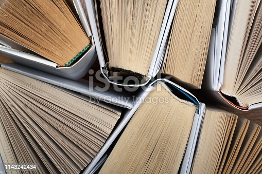istock Background from old and used hardback books. Copy space for text. 1143242434