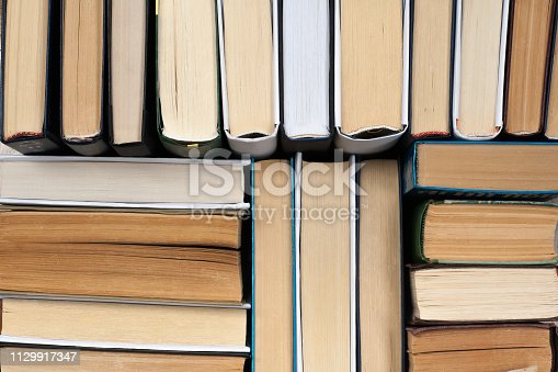 istock Background from old and used hardback books. 1129917347