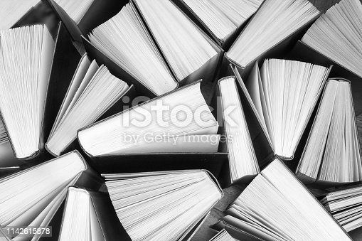 istock Background from old and used hardback books. 1142615878