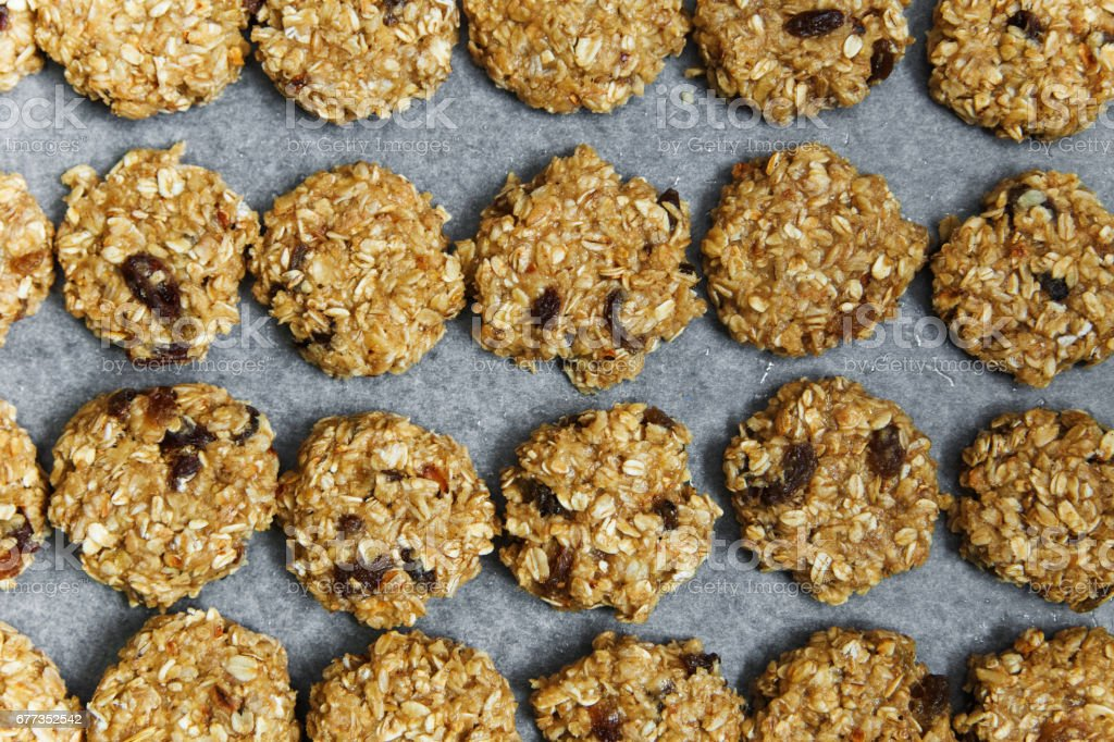 background from raw oat cookies. stock photo