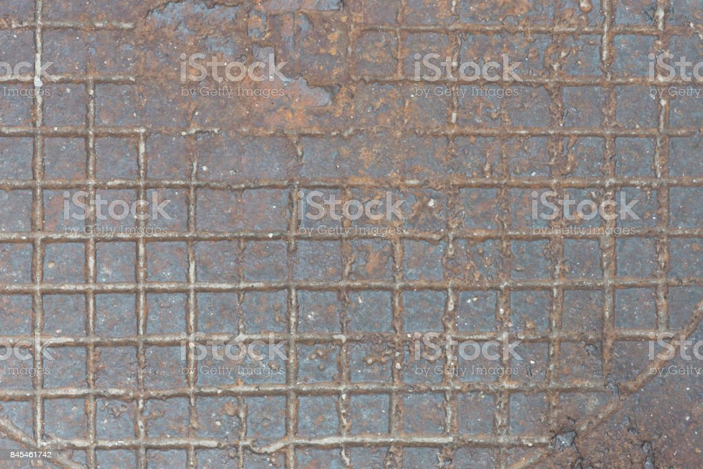 Background from rusty cast iron with the checkered relief drawing стоковое фото