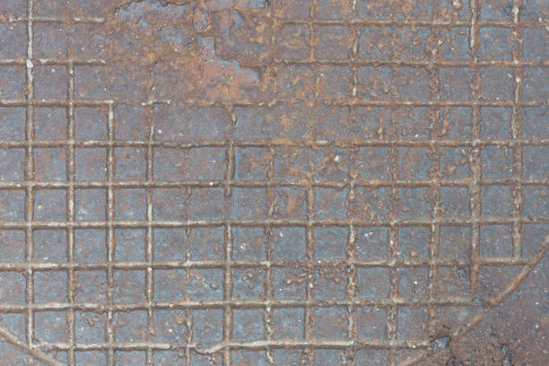 Cтоковое фото Background from rusty cast iron with the checkered relief drawing