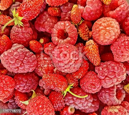 610771802 istock photo Background from summer red berries. 1257718272