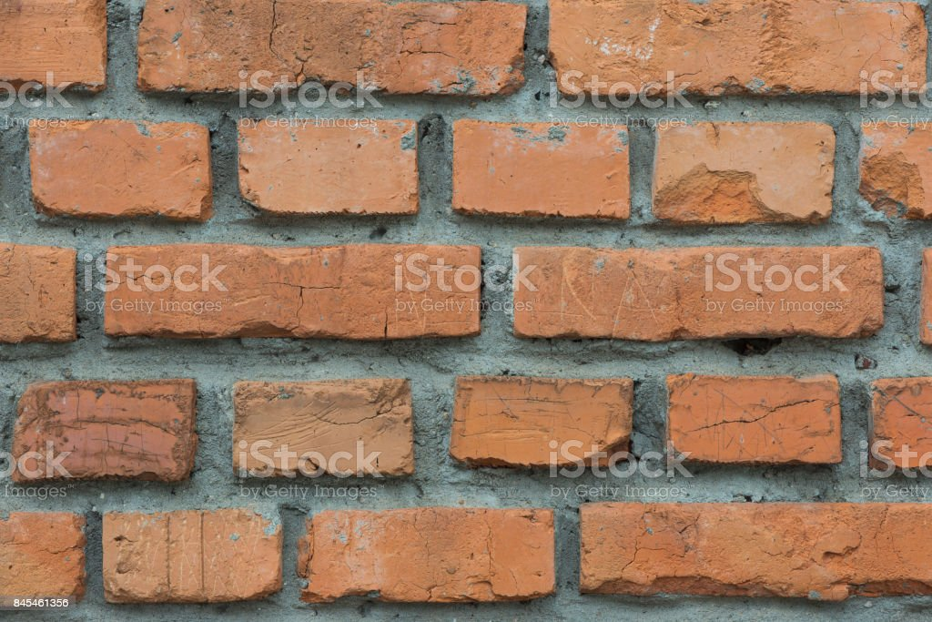 Background from the red brick laid with cement mortar close up стоковое фото