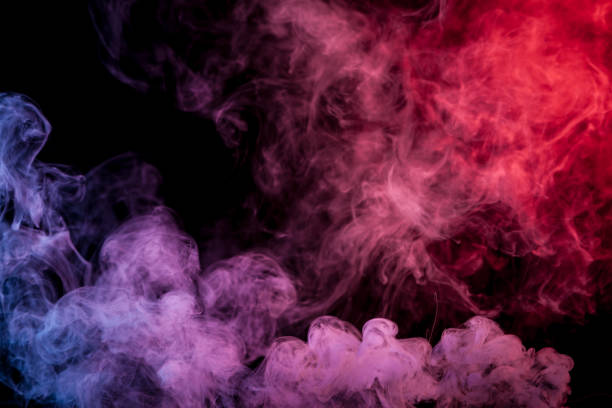 Background from the smoke of vape Red and blue  smoke on black background paranormal stock pictures, royalty-free photos & images