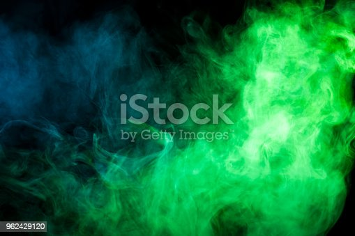 Green  and blue smoke on black background