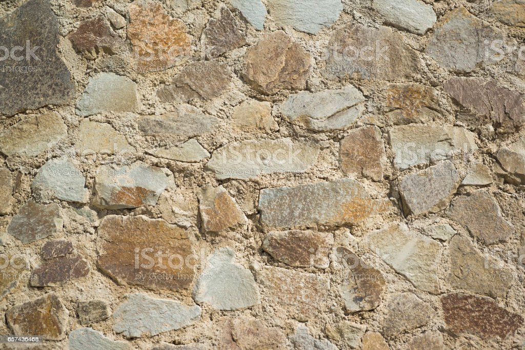 Background from the wall built from large natural stone limestone....