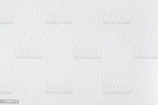 Photo of Background from white paper texture. Bright exclusive background, pattern close-up.