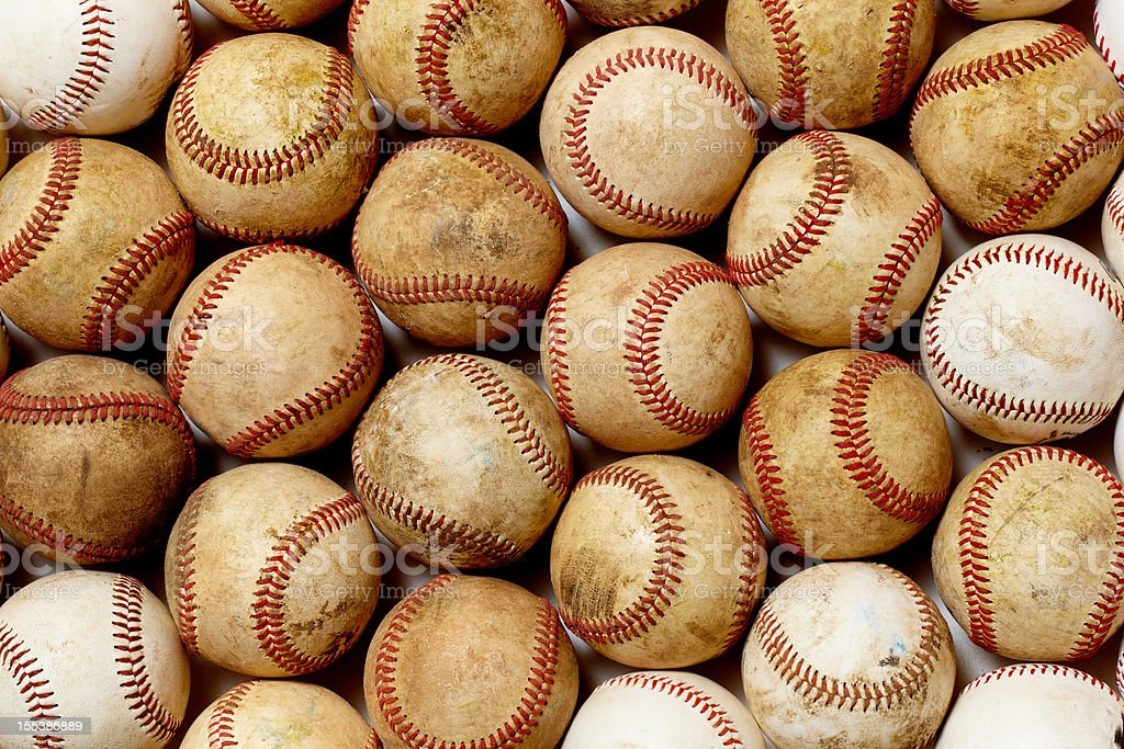 Background graphic of dirty baseballs with red lacing royalty-free stock photo