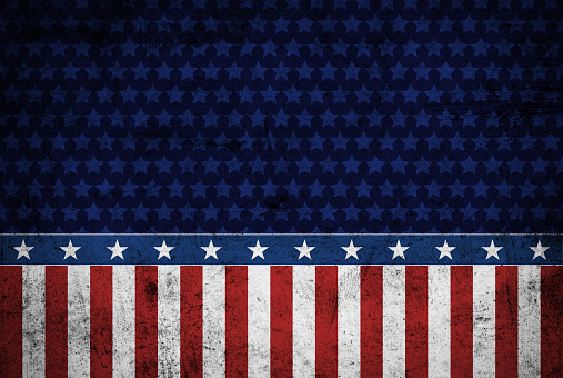 USA flag elements superimposed on dirty metal texture in grunge style. Layer effect and color manipulation with Photoshop.