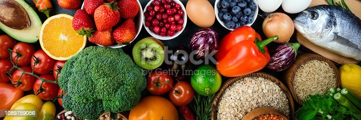 istock Background healthy food. Fresh fruits, vegetables, fish, berries and cereals. Healthy food, diet and healthy life concept. Top view 1089759056