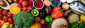 Background healthy food. Fresh fruits, vegetables, fish, berries and cereals. Healthy food, diet and healthy life concept. Top view. Long web format