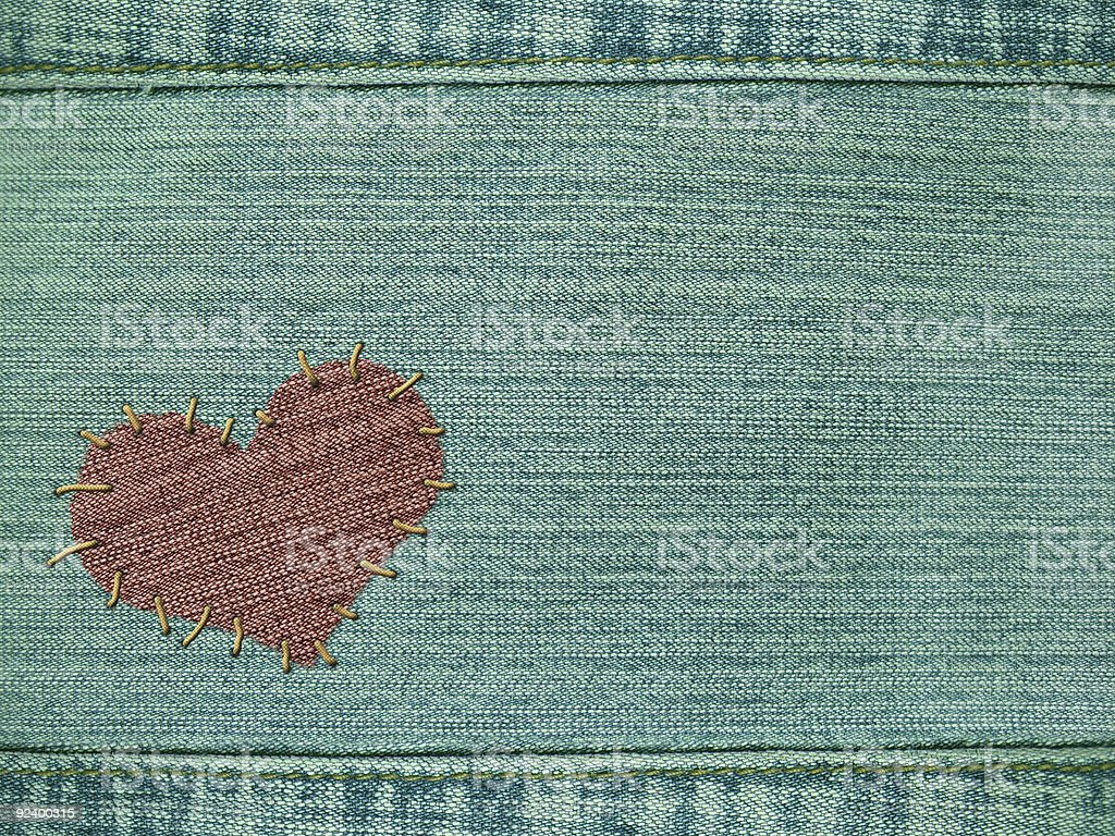 Background - heart attached by threads to jeans royalty-free stock photo