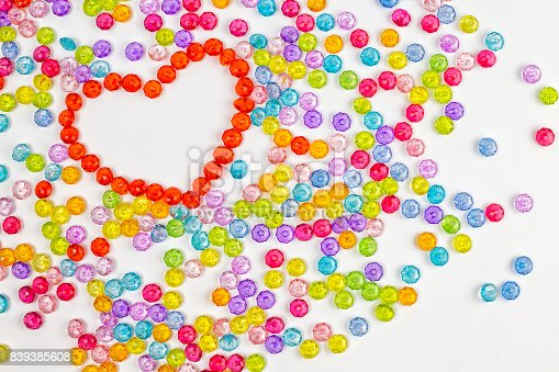 istock Background heart made of colored acrylic beads 839385608
