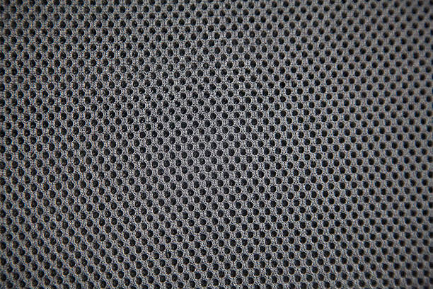 background holes spots gray pattern textile material nylon clothing cotton - mesh textile stock photos and pictures