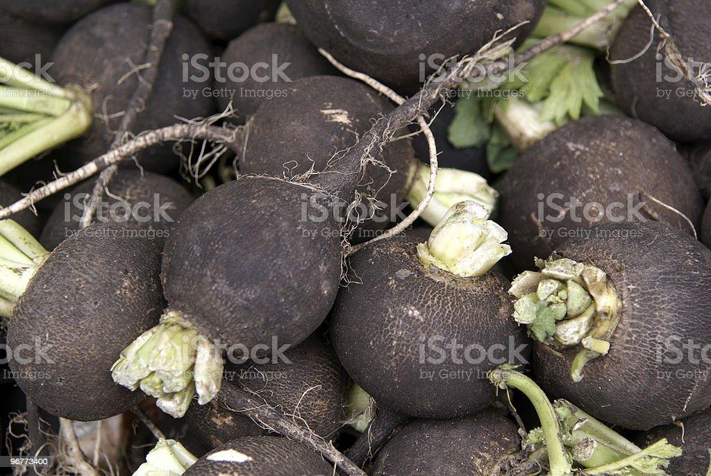 Background image featuring a pile of black radishes stock photo