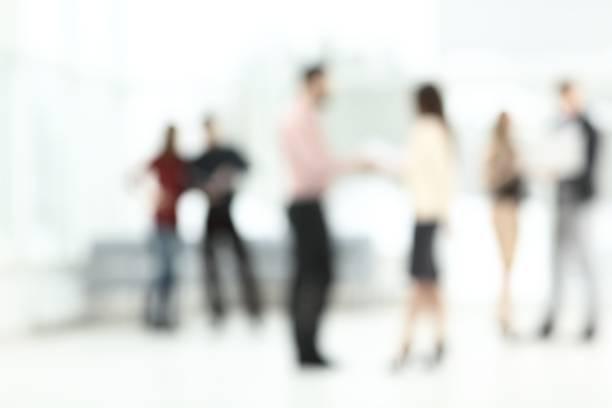 Hintergrundbild eines Business-Teams sprechen in der Büro-Halle – Foto